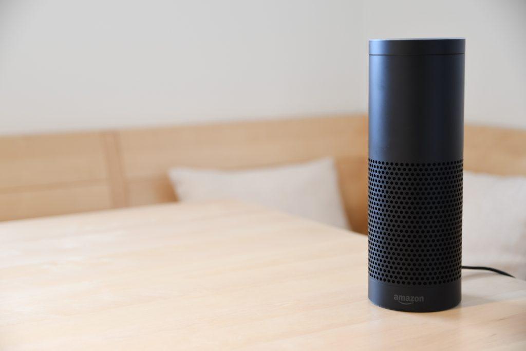 Black Amazon Echo dot on a table